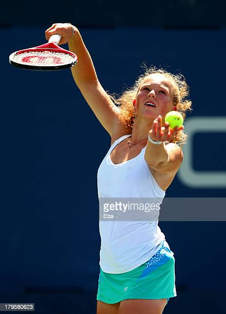 Katerina Siniakova of Czech Republic serves during her girls' singles third round match against Maria Marfutina of Russia on Day Eleven of the 2013...