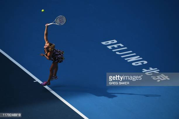 TOPSHOT Katerina Siniakova of Czech Republic serves during her women's singles third round match against Caroline Wozniacki of Denmark at the China...