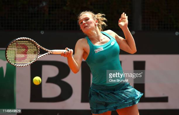 Katerina Siniakova of Czechia plays a forehand against Daria Kasatkina of Russia in their Women's Singles Round of 32 Match during Day Five of the...