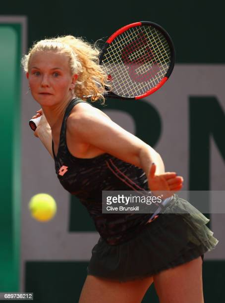 katerina Siniakova of The Czech republic plays a backhand during the ladies singles first round match against Ekaterina Alexandrova of Russia on day...