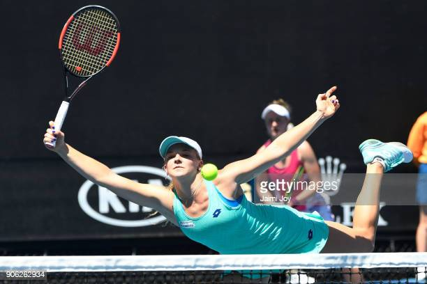 Katerina Siniakova of the Czech Republic plays a forehand in her first round women's doubles match with Barbora Krejcikova of the Czech Republic...