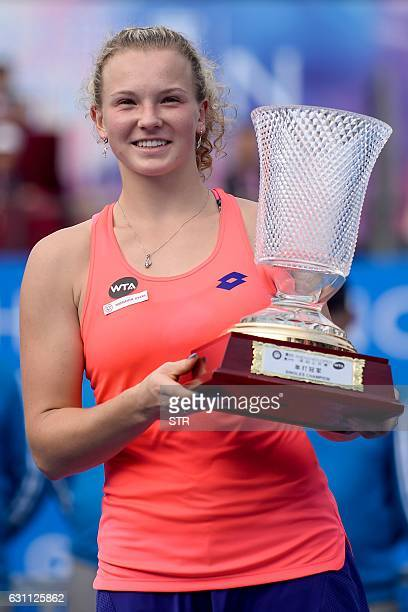 Katerina Siniakova of the Czech Republic poses with her trophy after winning the women's singles final match against Alison Riske of the US at the...