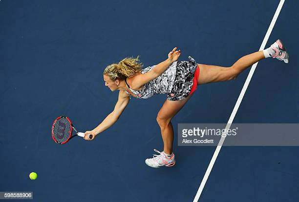 Katerina Siniakova of the Czech Republic returns a shot to Caroline Garcia of France during her second round Women's Singles match on Day Four of the...