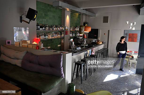 MAKRIS Katerina walks at her newly opened caffeebar in Athens on January 29 2014 Katerina a 26year pharmaceutical sector veteran opened a bar in...