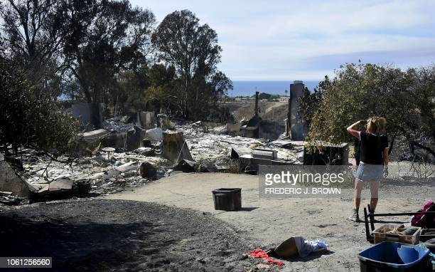 Katerine Marinara looks toward where her house on Busch Drive once stood a casualty of the Woolsey Fire on November 13 2018 in Malibu California At...