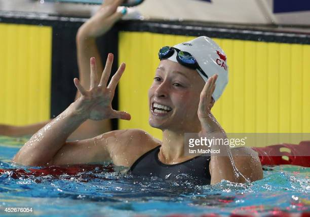 Katerine Savard of Canada celebrates winning the Women's 100m Butterfly at Tollcross International Swimming Centre during day two of the Glasgow 2014...