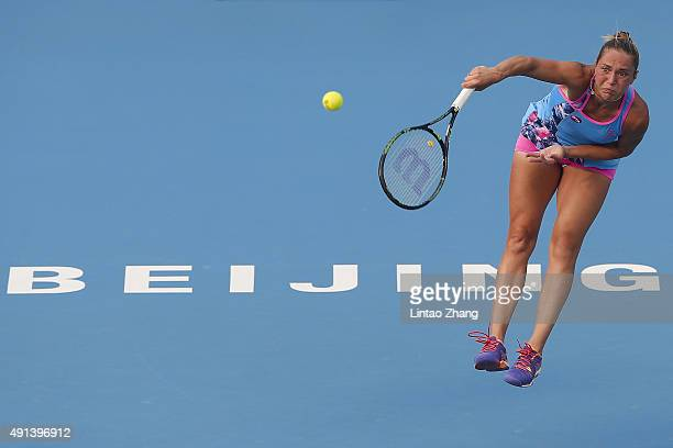 Kateryna Bondarenko of the Ukraine serves to Madison Keys of the United States during the Women's singles first round match on day three of the 2015...