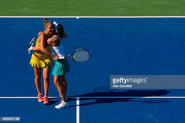 Kateryna Bondarenko of Ukraine and ChiaJung Chuang of Taiwan celebrate after defeating Timea Babos of Hungry and Yaroslava Shvedova of Kazakhstan on...