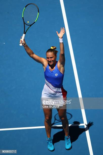 Kateryna Bondarenko of Ukraine celebrates winning match point in her second round match against Anastasia Pavlyuchenkova of Russia on day three of...