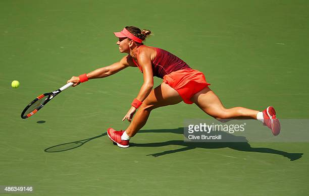 Kateryna Bondarenko of Ukraine returns a shot to Simona Halep of Romania during their Women's Singles Second Round match on Day Four of the 2015 US...