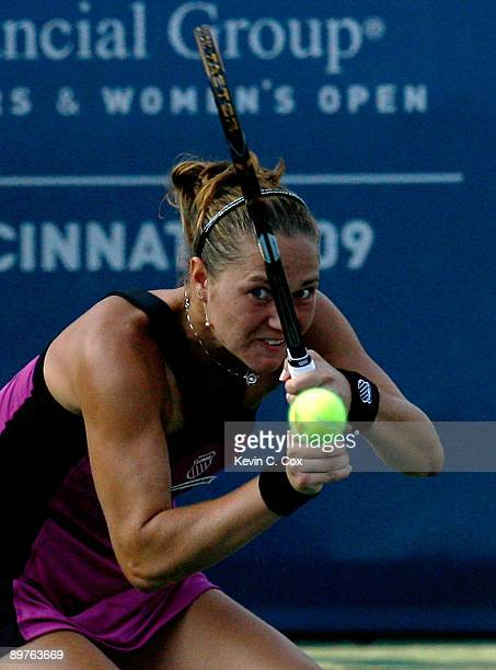 Kateryna Bondarenko returns a shot against Serena Williams during Day 3 of the Western Southern Financial Group Women's Open on August 12 2009 at the...