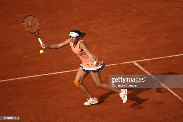 Kateryna Kozlova of Ukraine plays a forehand during her ladies singles first round match against Jelena Ostapenko of Latvia during day one of the...