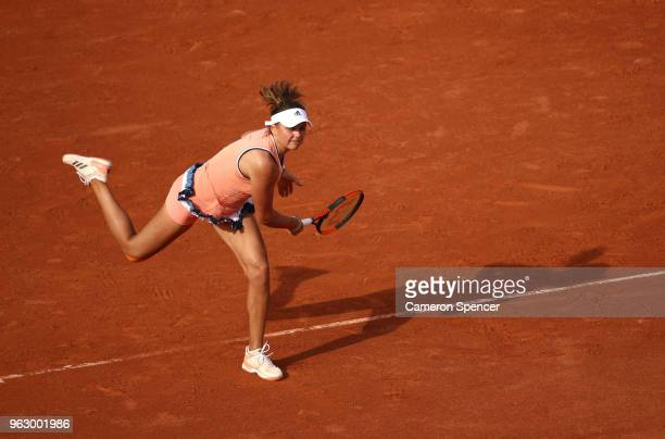 Kateryna Kozlova of Ukraine serves during her ladies singles first round match against Jelena Ostapenko of Latvia during day one of the 2018 French...