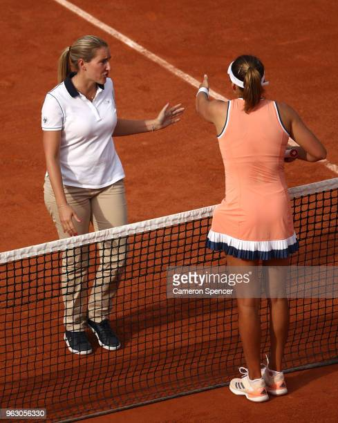 Kateryna Kozlova of Ukraine speaks to the umpire during her ladies singles first round match against Jelena Ostapenko of Latvia during day one of the...