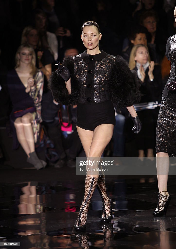 Kates Moss walks the runway at the Louis Vuitton Ready to Wear Autumn/Winter 2011/2012 show during Paris Fashion Week at Cour Carree du Louvre on March 9, 2011 in Paris, France.