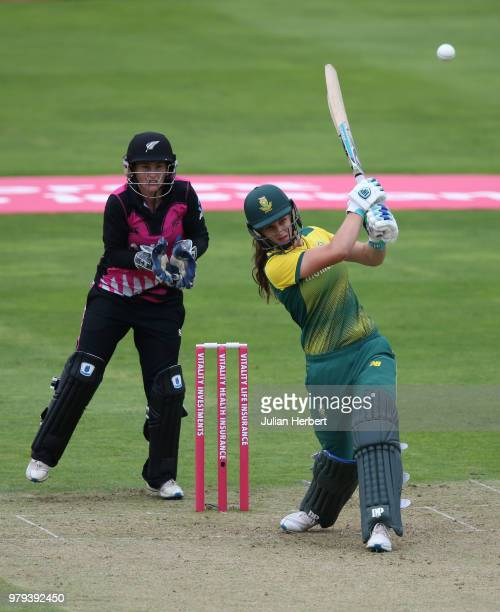 Katey Martin of South Africa looks on as Laura Wolvaardt of South Africa scores runs during the International T20 TriSeries match between New Zealand...