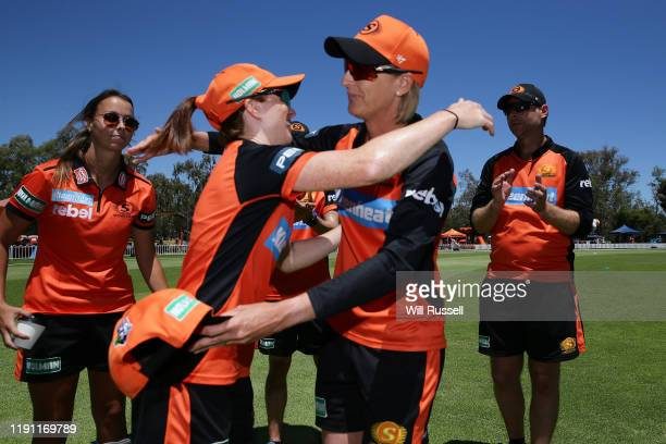 Kath Hempenstall of the Scorchers receiving her cap during the Women's Big Bash League match between the Hobart Hurricanes and the Perth Scorchers at...