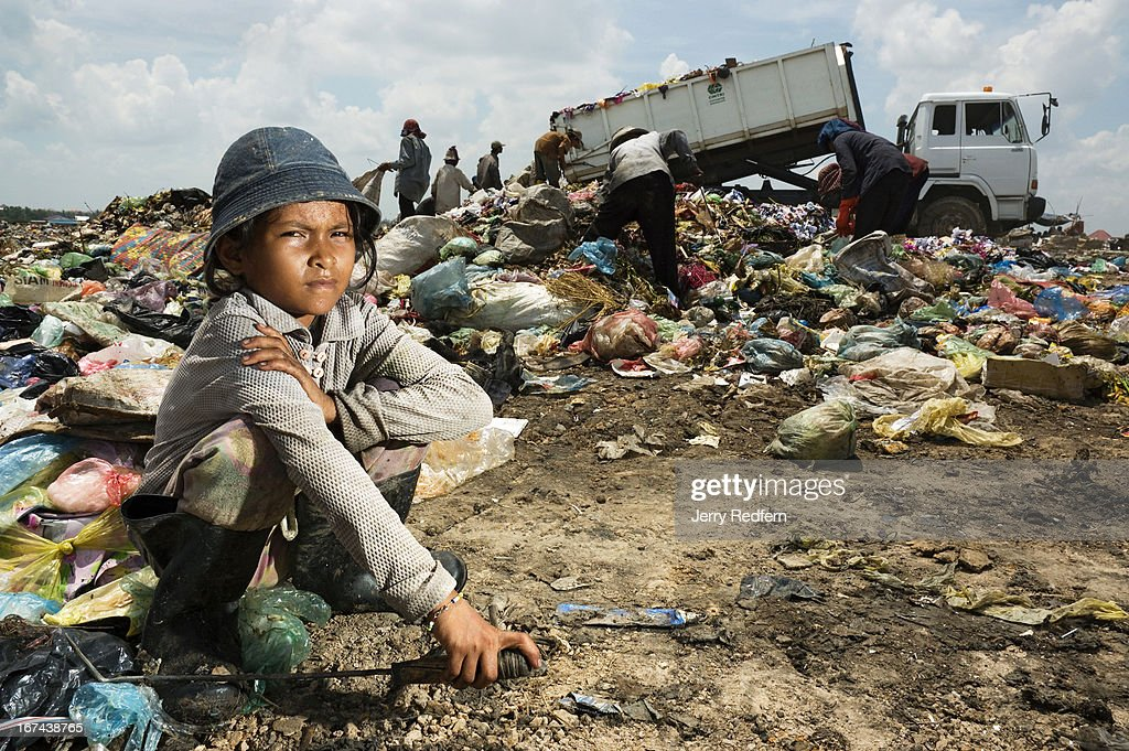 Kath Piya, 12, came to Phnom Penh with her parents about five years ago to work in the dump. Her parents returned home, but Kath Piya still collects at the dump, and lives with an uncle. She works every day until 5 PM, making $0.25 to $0.50. 'I'm homesick and I miss my parents,' she says. The vast majority of Cambodian children work. Their labor is imperative for their survival and the survival of their families. In rural areas, kids are expected to work beside their parents on farms. In cities, they are sent out to sell flowers, drinks or shine shoes for extra money. Everywhere, as soon as they are able, children are expected to take care of their younger siblings and take up difficult family chores, work that is usually reserved for parents or servants in the developed world. In Cambodia, kids work everywhere, and form a significant, underreported part of the country's economy..