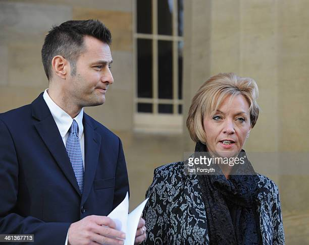 Kath Rathband stands next to solicitor Philip Davison as he gives a statement to the media at the end of the inquest into the death of her former...