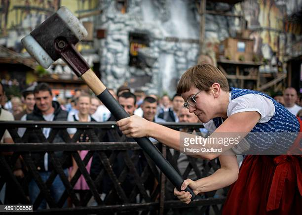Katha swings the hammer during a game of 'Hau den Lukas' on the opening day of the 2015 Oktoberfest on September 19 2015 in Munich Germany The 182nd...