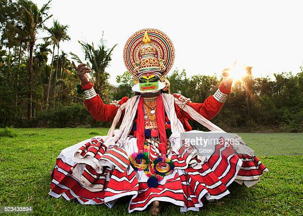 kathakali dancer performing in open field. kerala, southern india - hugh sitton india stock pictures, royalty-free photos & images