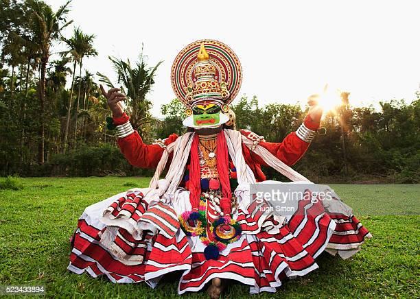 kathakali dancer performing in open field. kerala, southern india - hugh sitton stockfoto's en -beelden
