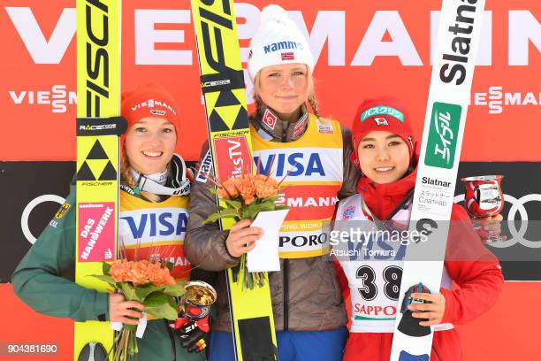 Katharina Althaus of Germany , Maren Lundby of Norway and Sara Takanashi of Japan pose on the podium after the Ladies normal hill individual during...