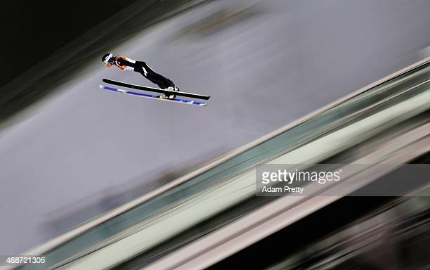 Katharina Althaus of Germany soars through the air during the Ladies' Normal Hill Individual first round on day 4 of the Sochi 2014 Winter Olympics...