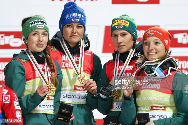 Katharina Althaus Ramona Straub Carina Vogt and Juliane Seyfarth of Germany celebrate winning the HS109 women's ski jumping Competition of the FIS...