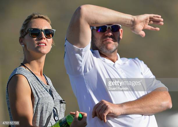 Katharina Boehm girlfriend of Sergio Garcia of Spain and caddie Neil Wallace look on during practice prior to the start of the World Golf...