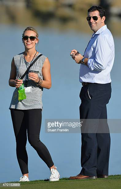 Katharina Boehm girlfriend of Sergio Garcia of Spain and his manager look on during practice prior to the start of the World Golf Championships...