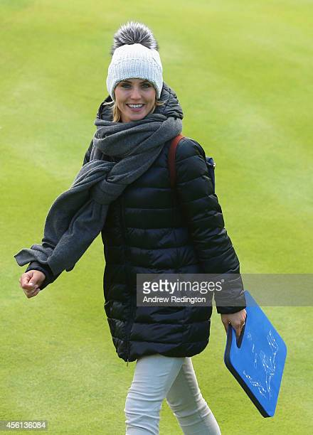 Katharina Boehm, partner of Sergio Garcia of Europe smiles during the Morning Fourballs of the 2014 Ryder Cup on the PGA Centenary course at the...