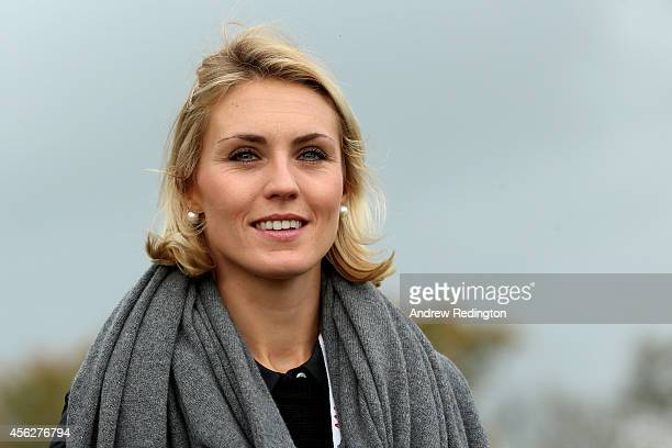 Katharina Boehm partner of Sergio Garcia of Europe watches during the Singles Matches of the 2014 Ryder Cup on the PGA Centenary course at the...