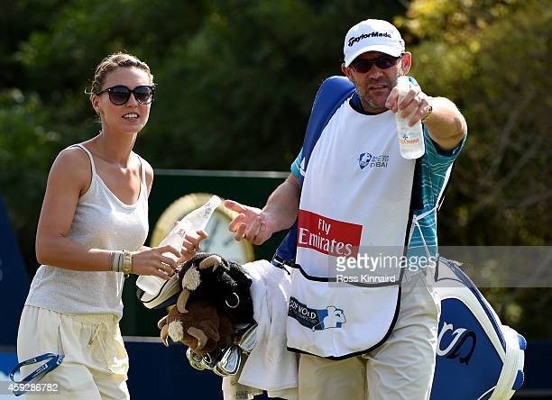 Katharina Boehm the girlfriend of Sergio Garcia collects a bottle of water from his caddie during the first round of the DP World Tour Championship...
