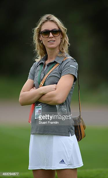 Katharina Boehm watches her friend Sergio Garcia of Spain during the pro am prior to the start of the Nedban Golf Challenge at Gary Player CC on...