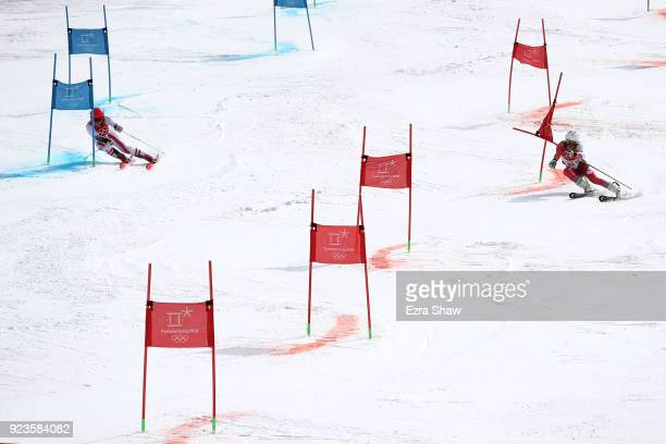Katharina Gallhuber of Austria and Wendy Holdener of Switzerland compete during the Alpine Team Event Big Final on day 15 of the PyeongChang 2018...
