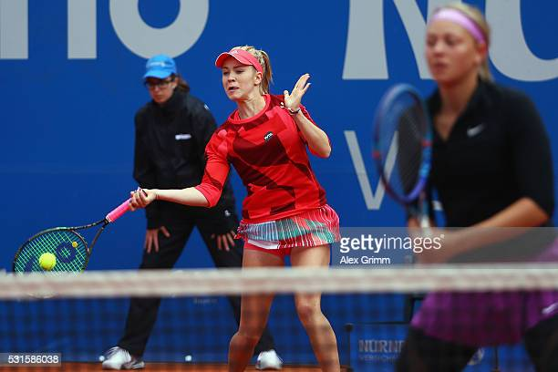 Katharina Hobgarski and Carina Witthoeft of Germany in action during their match against Annika Beck and AnnaLena Friedsam of Germany during Day Two...