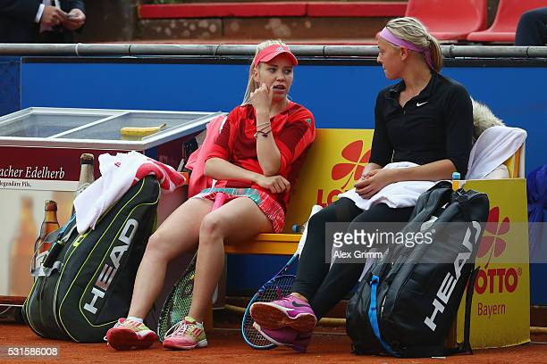 Katharina Hobgarski and Carina Witthoeft of Germany react during their match against Annika Beck and AnnaLena Friedsam of Germany during Day Two of...