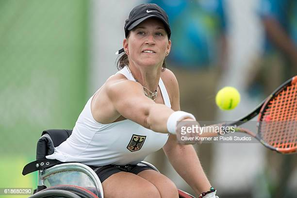 Katharina Krüger of Zehlendorfer Wespen/Berlin [paralympic classification n/a] reaching out long to get the ball returned on Day 3 of the Rio 2016...