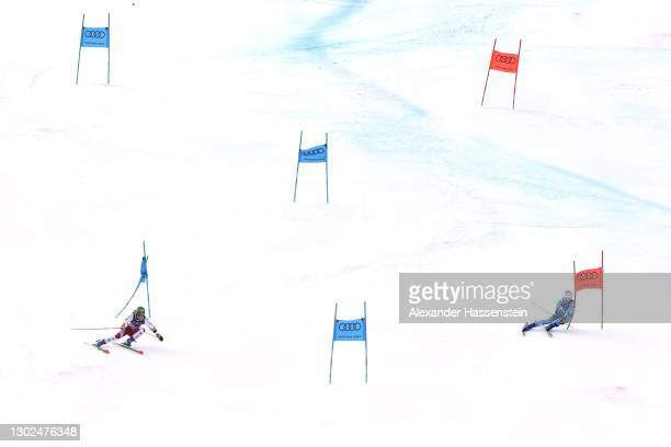 Katharina Liensberger of Austria competes against Marta Bassino of Italy in the Big Final of Women's Parallel Giant Slalom during the FIS World Ski...
