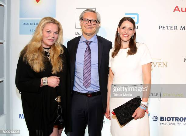 Katharina Otto-Bersnstein, Alexander Otto and his wife Dorit Otto attend the Charity Evening 'Das kleine Herz im Zentrum' at Curio Haus on June 22,...