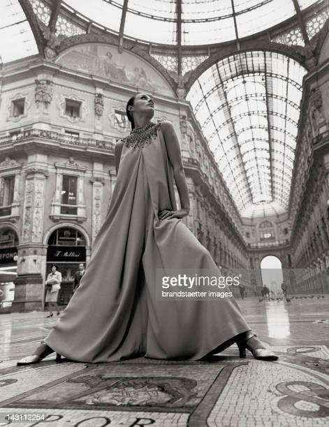 Katharina Sarnitz in a creation of Hubert de Givenchy. Galleria Vittorio Emanuele II. Milan. Photograph. 1969.