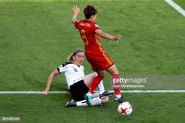 Katharina Schiechtl of Austria tackles Amanda Sampedro of Spain during the UEFA Women's Euro 2017 Quarter Final match between Austria and Spain at...