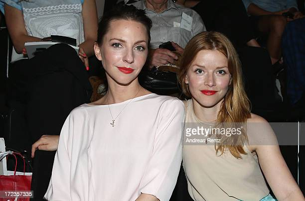 Katharina Schuettler and Karoline Schuch attend the Malaikaraiss Show during MercedesBenz Fashion Week Spring/Summer 2014 at Brandenburg Gate on July...