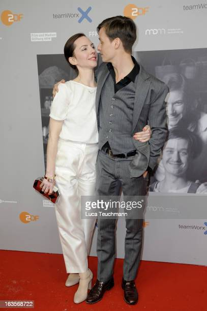 Katharina Schuettler and Tom Schilling attend the Premiere of 'Unsere Muetter Unsere Vaeter' at the Astor Film Lounge on March 12 2013 in Berlin...