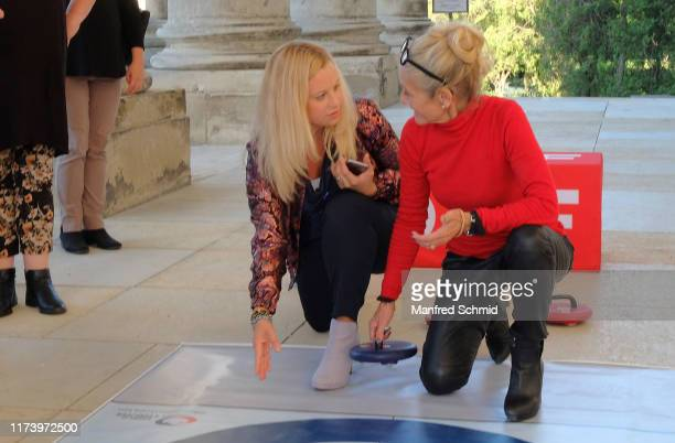 Katharina Strasser and Katharina Zechner pose during the 'Curling For Eisenstadt' pre-premiere at Schloss Esterhazy on September 10, 2019 in...