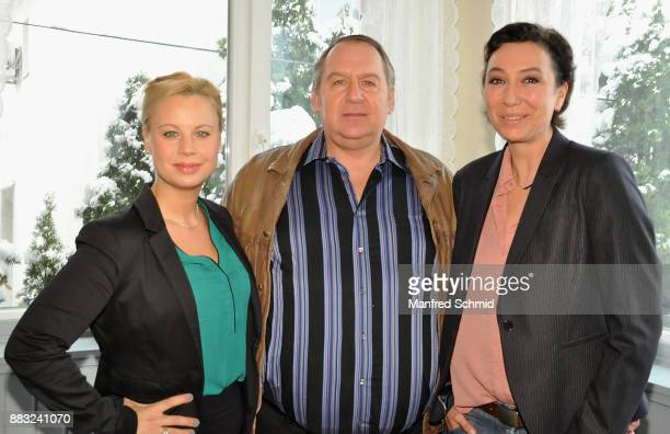Katharina Strasser, Wolf Bachofner and Ursula Strauss pose during the tv series 'Schnell ermittelt' On Set Photo Call at Schutzhaus am Schafberg on...