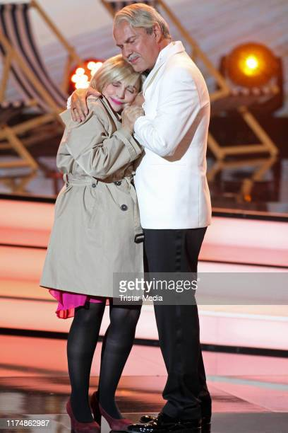 """Katharina Thalbach and Uwe Ochsenknecht at the charity gala """"Willkommen bei Carmen Nebel"""" at TUI Arena on September 14, 2019 in Hanover, Germany."""