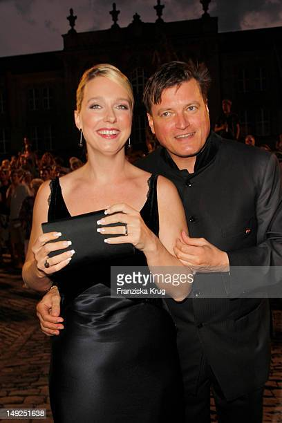 Katharina Wagner and Christian Thielemann arrive for the reception of the Bavarian state governor after the Bayreuth festival 2011 premiere on July...