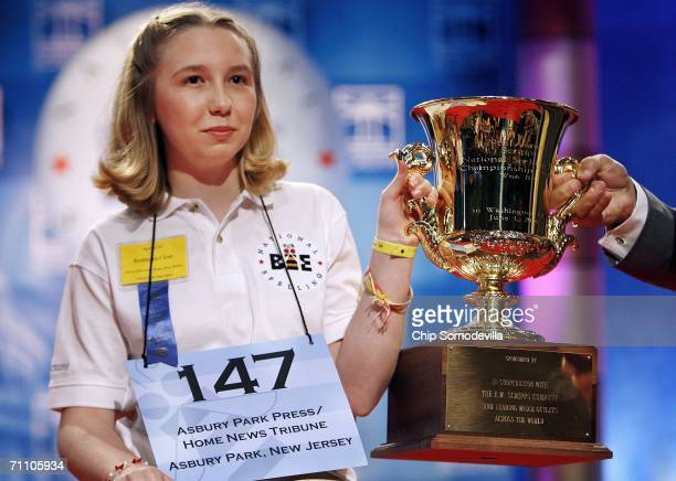 Katharine Close of Spring Lake New Jersey holds up the championship trophy after winning the 2006 Scripps National Spelling Bee June 1 2006 in...